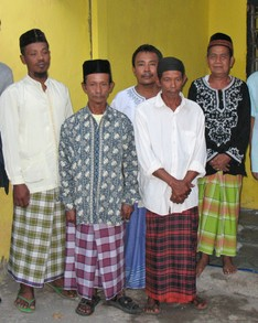 A group of Indonesians wearing sarongs