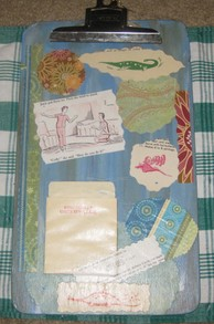 Front of clipboard with decoupaged papers.