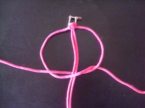 Now repeat but this time curl the left hand cord over the stationary cords,weave the left hand cord over,under,through