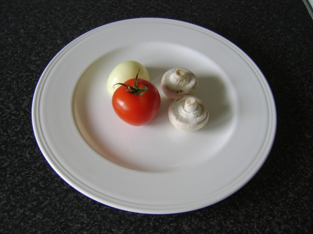 Two small closed cup mushrooms one small tomato and half a white onion