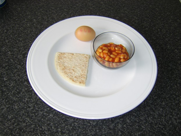 One tattie scone, one egg and two tablespoons of baked beans in tomato sauce