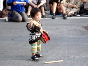A tiny Eisa Drummer.  Many Okinawan children take up Eisa drumming.