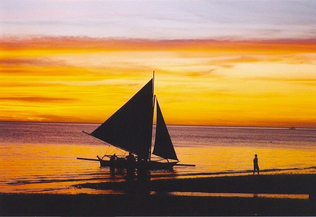 Sunset over White Beach at Borocay Island