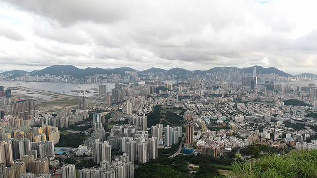 Kowloon and Hong Kong. The old Kai Tak Airport can be seen on the left.