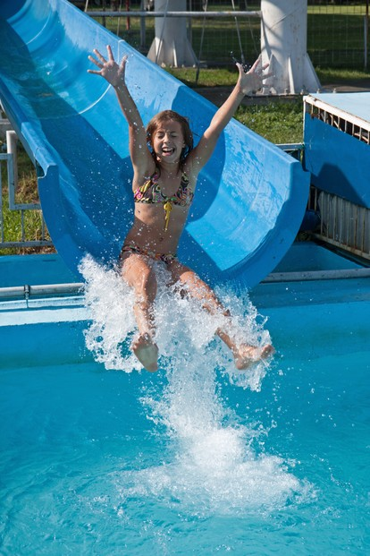 Teenage Girl Enjoying Waterpark Ride