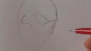 Now draw in the skulls nose, mark in the teeth and cheek bone.
