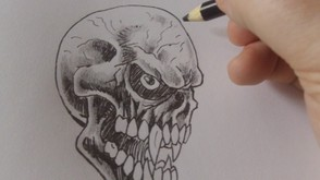 Shade the entire skull with a black crayola pencil.