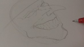 Define the chin and sketch in lines for the teeth.