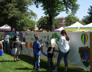 Everyone enjoys working on the public mural each year.
