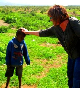 Maasai Child Greeting Adult