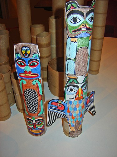 Totems taped onto empty cardboard rolls