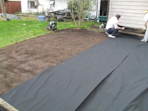 placing landscape fabric