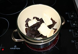 Melt the chocolate and butter over simmering water
