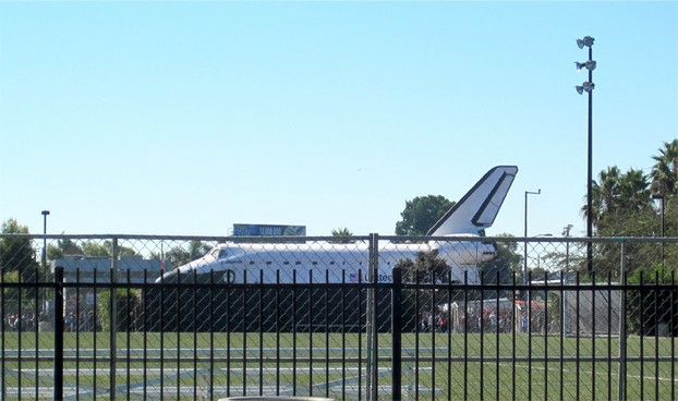 At 10:50, Endeavour inches into view on MLK Jr Blvd