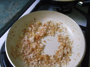 Saute the breadcrumbs in oil, garlic and paprika.