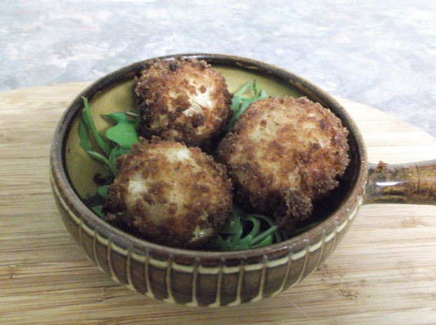 Cheese balls with rice and onion, served here on a bed of rocket.