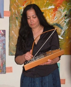 Bina plays a bowed psaltery