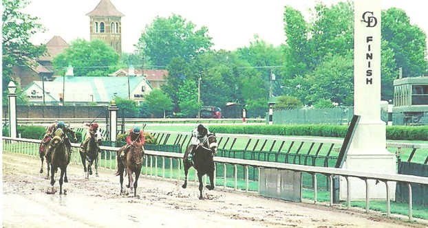 Thoroughbreds approach the finish line in sloppy going at Churchill Downs