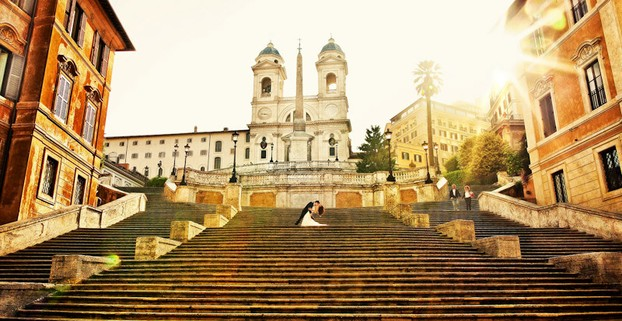 Newlyweds pose for photographs on the Spanish Steps, Rome