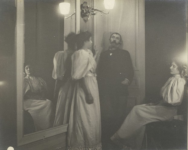 Portrait of Henry Lerolle with two of his daughters, Yvonne and Christine and a mirror