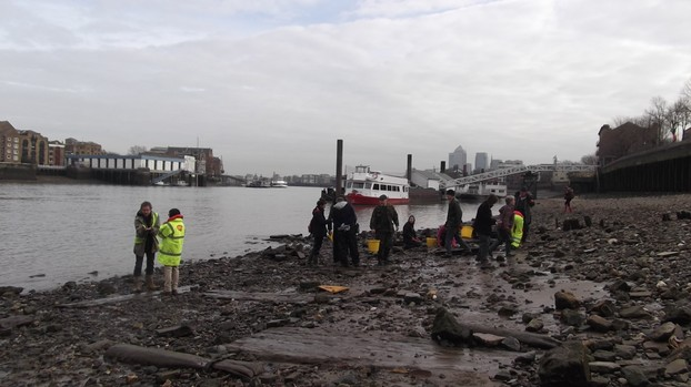 A group exploring the Thames Foreshore