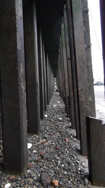 Under the pier on the Thames foreshore