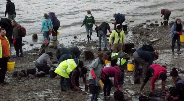 Volunteers excavating on the Greenwich Foreshore