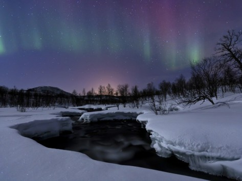 Aurora Borealis over Blafjellelva River in Troms County, Norway