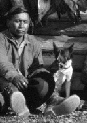 A Tahltan man with his Bear Dog.