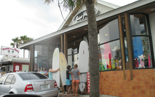 Rent surfboards, buy food, or shop for gifts, along Flagler Ave.
