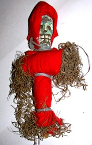 Cursed Voodoo doll made from the intended target's clothing