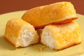 Twinkies are a cake-y cream filled sugary junk food snack.