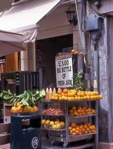 Street stall with fruit and freshly squeezed drinks