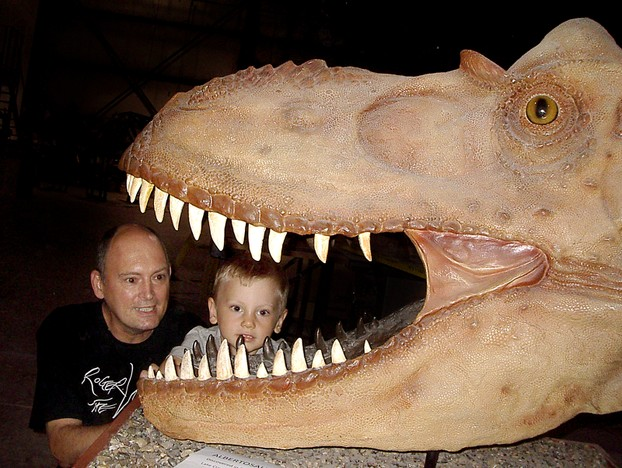 Rick Hyde and his 4-year-old grandson, Channing, check out an Albertosaurus during the 2012 Open House at RCI.