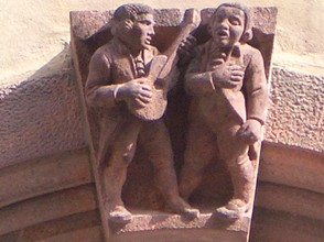 Figures over City Hall