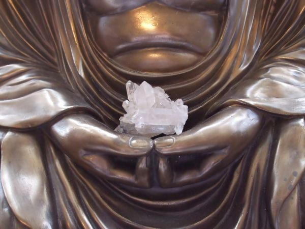 Buddha holding a crystal for meditation