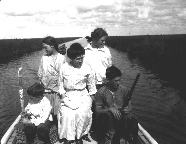 Small family (George, Kathryn, Elizabeth W., Elizabeth, John) on cruiser Lida, Everglades near Lake Okeechobee, Nov 1913