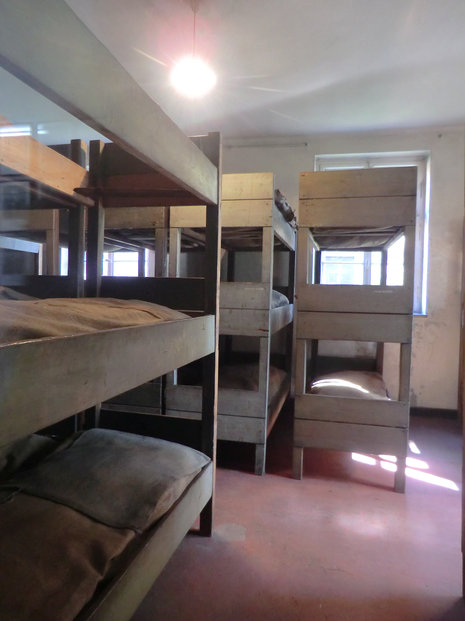 Image: Men slept three to a bunk in these Auschwitz I barracks.