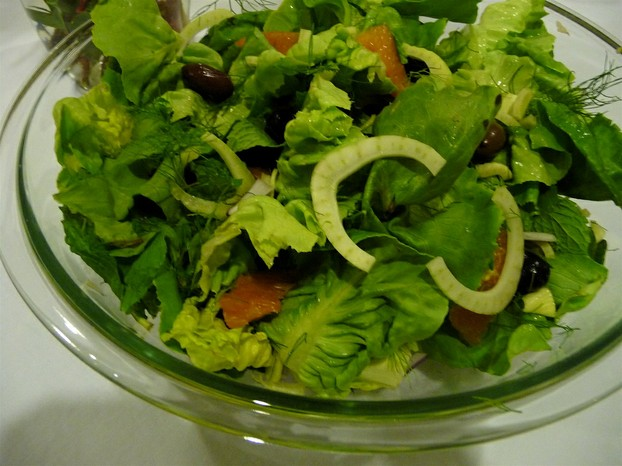 basic ingredients for refreshing salad: fennel, lettuce, and olives; delicious additions: cheese, oranges, tomatoes