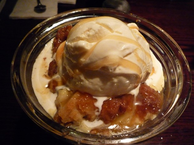 Apple dump cobbler, topped with melting ice cream, is lusciously delicious.