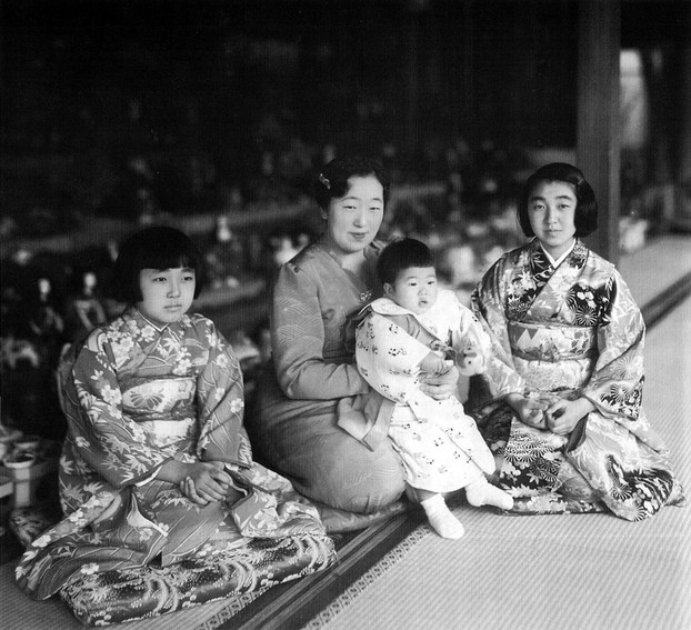 Empress Kōjun (March 6,1903–June 16, 2000) with princesses and tiered dolls during Japan's annual Doll Festival, c1940