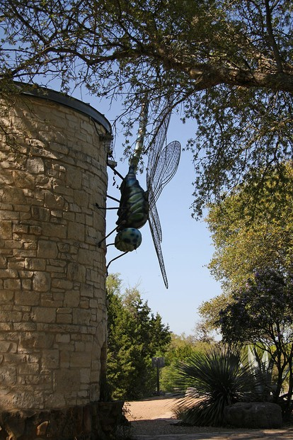 giant dragonfly sculpture on side of stone water cistern tower, Lady Bird Johnson Wildflower Center, Austin, Texas
