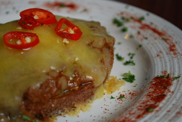 Chili beef in rich paprika spiked sauce atop rye toast, and smothered with cheddar cheese.