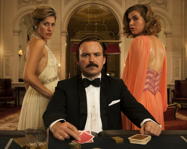 Rory Kinnear as Lord Lucan, flanked by actresses Mytle Vraets and Kya Garwood