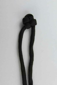 Make a single cross knot on another cord