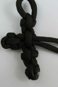 Pull the cord through the back of the four knots