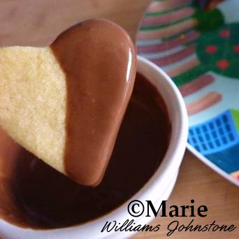 Dipping the Heart Shaped Sugar Cookie in Melted Chocolate