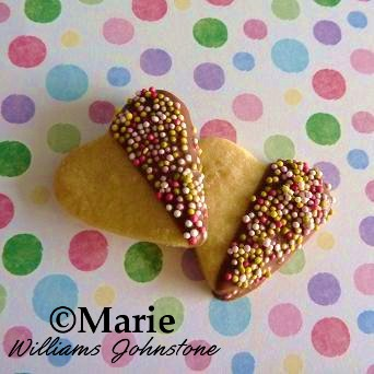 Chocolate dipped heart shaped sugar cookies with sprinkles