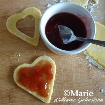 Adding in Jam Jelly Fruit Preserve to the Cookie Hearts