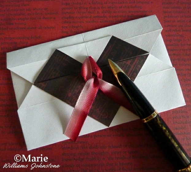 See how to fold a paper envelope with a heart motif on the front
